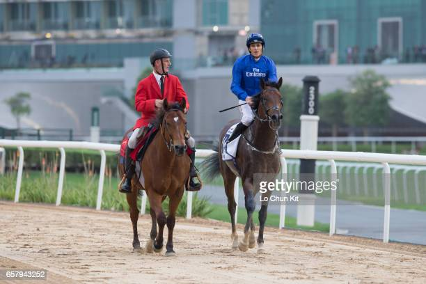 Christophe Soumillon riding Thunder Snow wins the UAE Derby Sponsored By The Saeed Mohammed Al Naboodah Group during the Dubai World Cup at the...