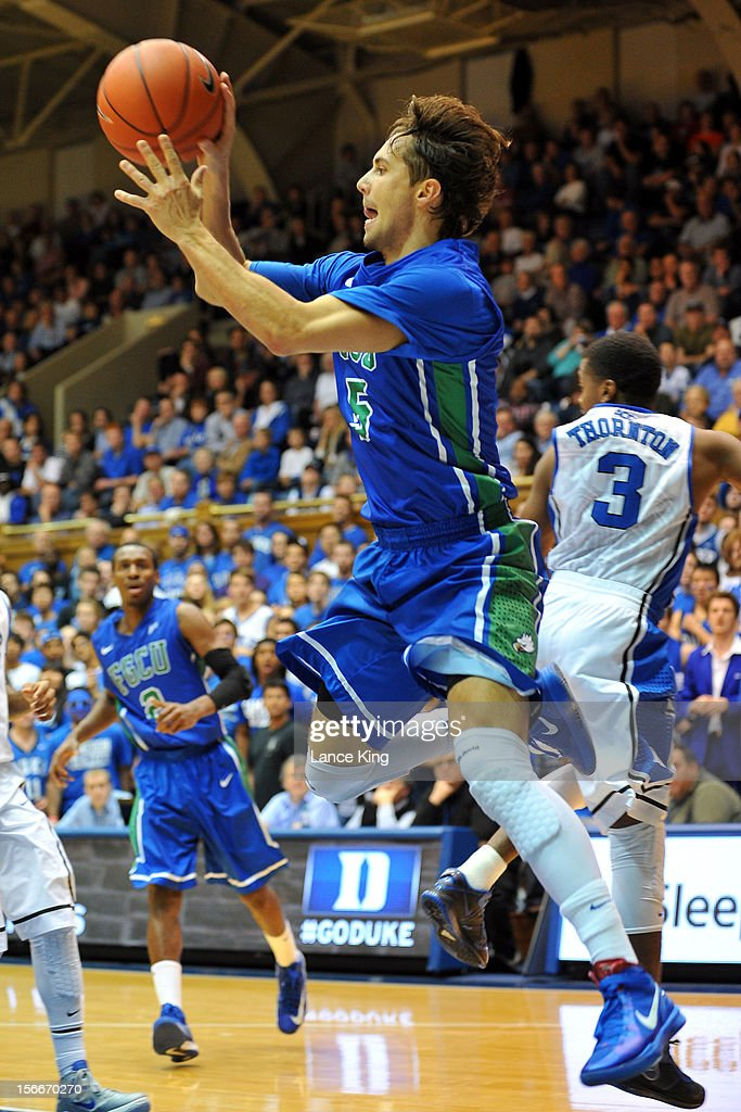 Christophe Varidel #5 of the Florida Gulf Coast Eagles looks to pass against the Duke Blue Devils at Cameron Indoor Stadium on November 18, 2012 in Durham, North Carolina. Duke defeated Florida Gulf Coast 88-67.
