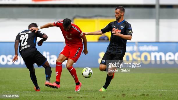 Christopher AntwiAdjej and Koen van der Biezen of Paderborn challenges Oezguer Oezdemir of Sonnenhof Grossaspach during the 3 Liga match between SC...