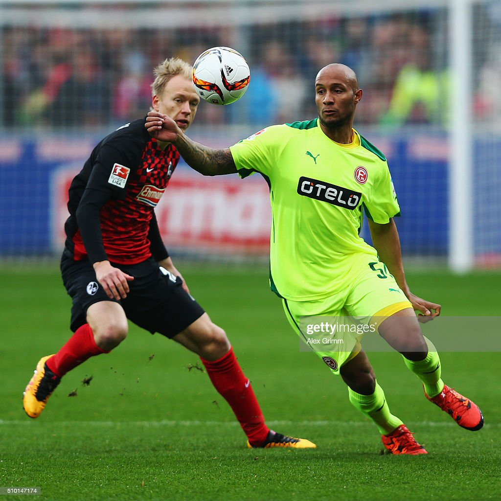 Christopher Avevor (R) of Duesseldorf is challenged by Havard Nielsen of Freiburg during the Second Bundesliga match between SC Freiburg and Fortuna Duesseldorf at Schwarzwald-Stadion on February 14, 2016 in Freiburg im Breisgau, Germany.