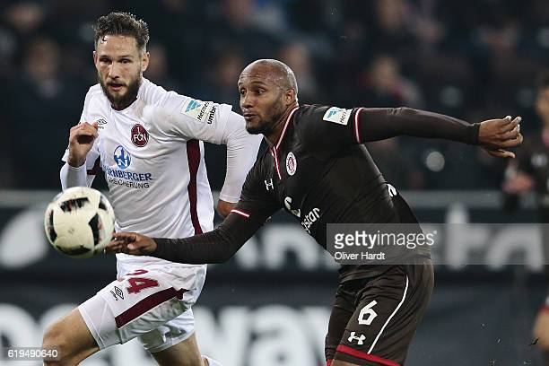 Christopher Avevor of Pauli and Tim Matavz of Nuernberg compete for the ball during the Second Bundesliga match between FC St Pauli and 1 FC...