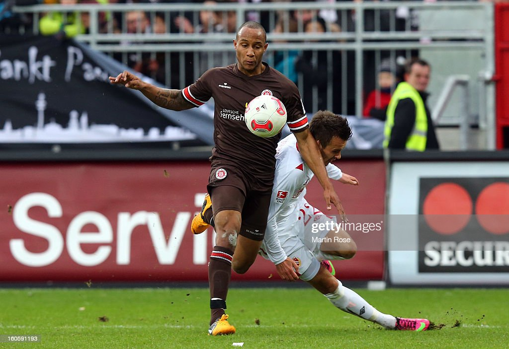 Christopher Avevor (L) of St. Pauli and Andre Fomitschow (R) of Cottbus battle for the ball during the second Bundesliga match between FC St. Pauli and Energie Cottbus at Millerntor Stadium at Millerntor Stadium on February 3, 2013 in Hamburg, Germany.