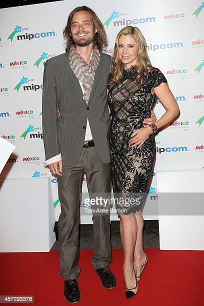 Christopher Backus and Mira Sorvino arrive at the MIPCOM opening Party at Hotel Martinez on October 13 2014 in Cannes France