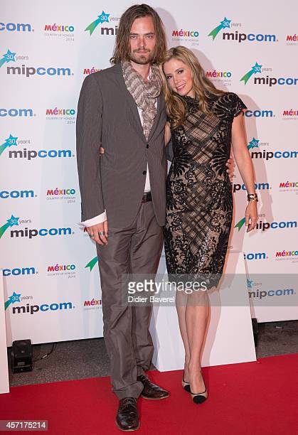 Christopher Backus and Mira Sorvino attend the opening red carpet party MIPCOM 2014 at Hotel Martinez on October 13 2014 in Cannes France