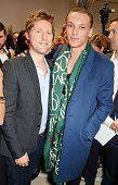 Christopher Bailey and Jamie Campbell Bower pose backstage at the Burberry Womenswear SS15 show during London Fashion week at Kensington Gardens on...
