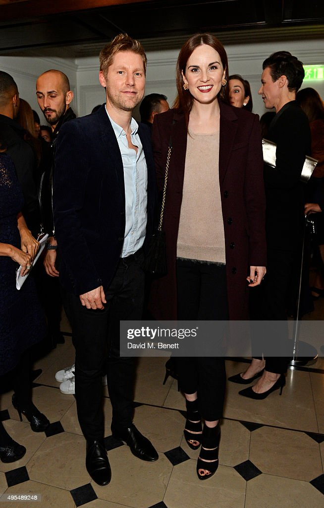 Christopher Bailey (L) and Michelle Dockery attend the Burberry Festive film premiere at 121 Regent Street on November 3, 2015 in London, England.