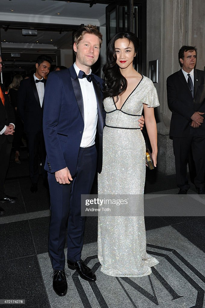 Christopher Bailey and Wei Tang depart The Mark Hotel for the Met Gala at the Metropolitan Museum of Art on May 4 2015 in New York City