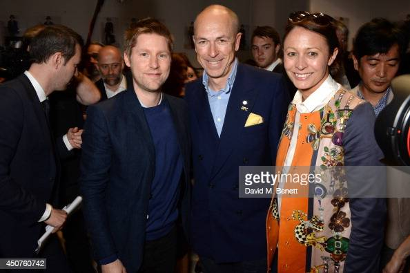 Christopher Bailey Dylan Jones and Caroline Rush pose for photographers backstage at Burberry Prorsum SS15 during London Collections Men at...