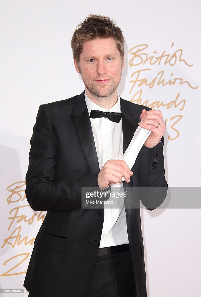 Christopher Bailey poses in the winners room at the British Fashion Awards 2013 at London Coliseum on December 2, 2013 in London, England.