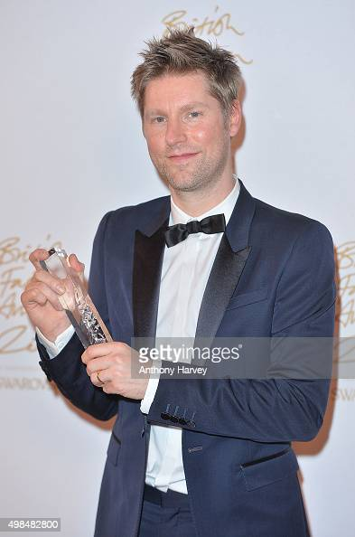 Christopher Bailey poses in the Winners Room at the British Fashion Awards 2015 at London Coliseum on November 23 2015 in London England