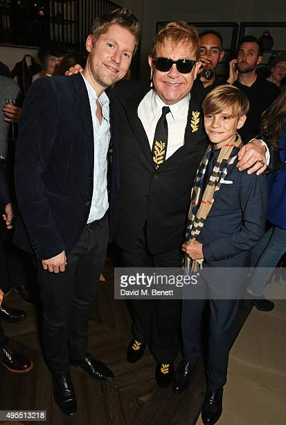 Christopher Bailey Sir Elton John and Romeo Beckham attend the Burberry Festive film premiere at 121 Regent Street on November 3 2015 in London...