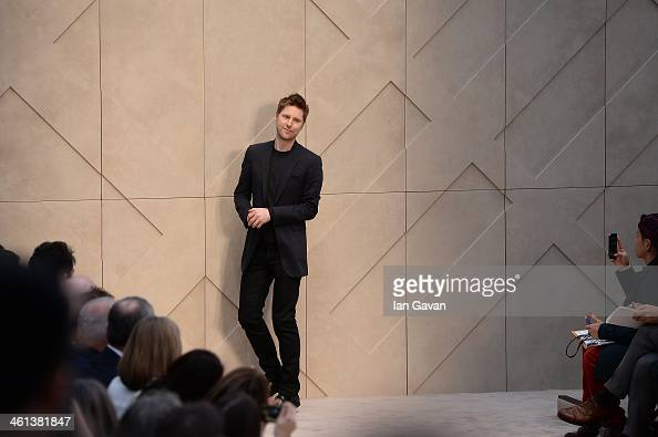 Christopher Bailey sits in the front row during Burberry AW14 Menswear Show at Kensington Gardens on January 8 2014 in London England