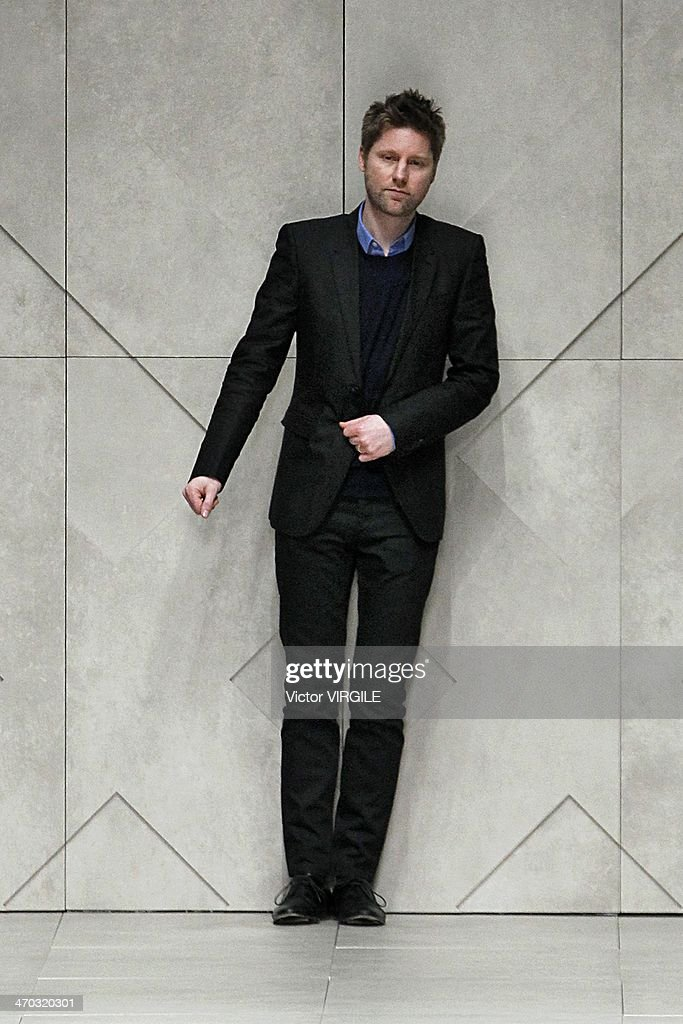 Christopher Bailey walks the runway at the Burberry Prorsum Ready to Wear Fall/Winter 20142015 show at London Fashion Week AW14 at Perks Fields...