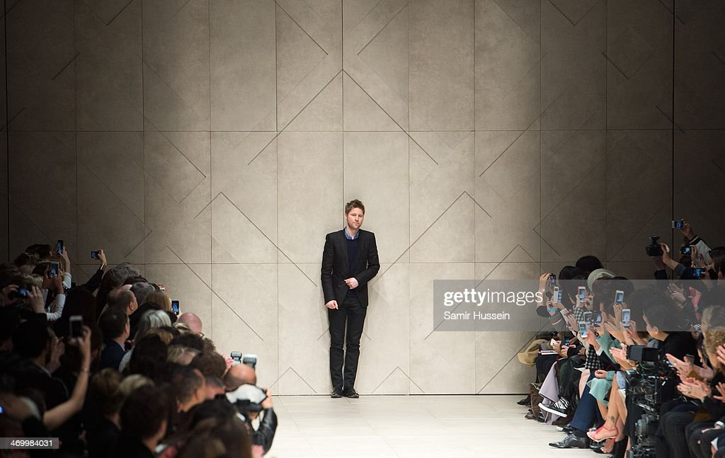 Christopher Bailey walks the runway at the Burberry Prorsum show at Perks Field during London Fashion Week AW14 in at the Kensington Gardens on...