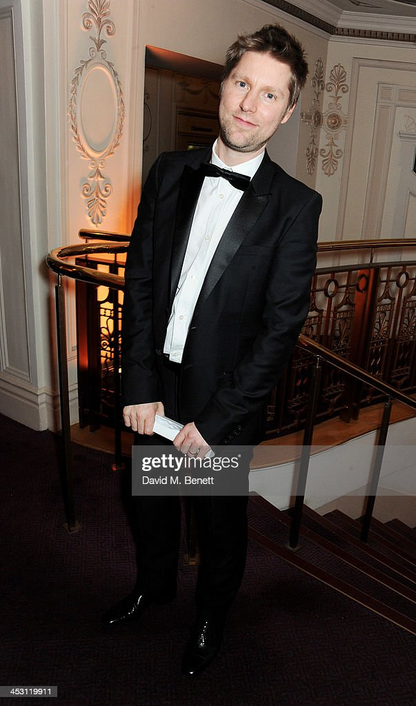 Christopher Bailey, winner of Menswear Designer of the Year, poses at the British Fashion Awards 2013 at London Coliseum on December 2, 2013 in London, England.