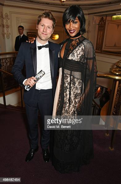 Christopher Bailey winner of the Creative Campaign award for Burberry and presenter Naomi Campbell attend the British Fashion Awards in partnership...