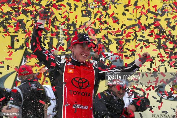 Christopher Bell driver of the JBL Toyota celebrates in Victory Lane after winning the NASCAR XFINITY Series Kansas Lottery 300 at Kansas Speedway on...