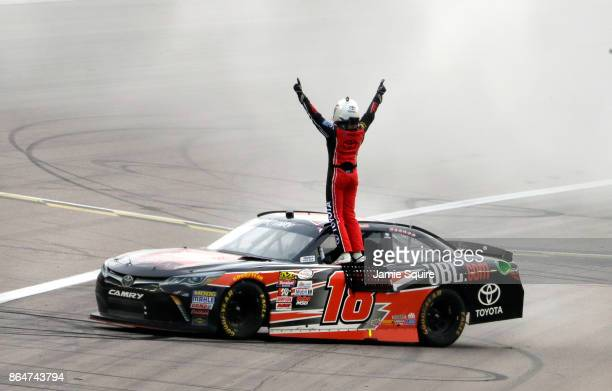 Christopher Bell driver of the JBL Toyota celebrates winning the NASCAR XFINITY Series Kansas Lottery 300 at Kansas Speedway on October 21 2017 in...
