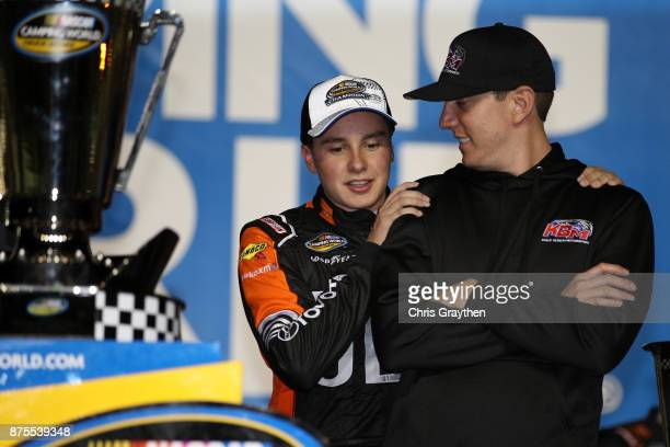 Christopher Bell driver of the JBL Toyota celebrates with team owner Kyle Busch and the trophy in Victory Lane after placing second and winning the...