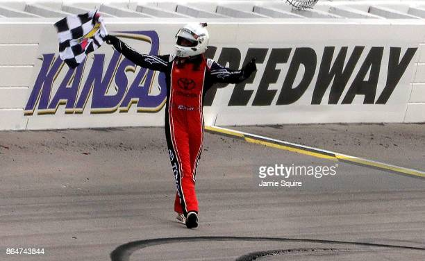Christopher Bell driver of the JBL Toyota celebrates with the checkered flag after winning the NASCAR XFINITY Series Kansas Lottery 300 at Kansas...