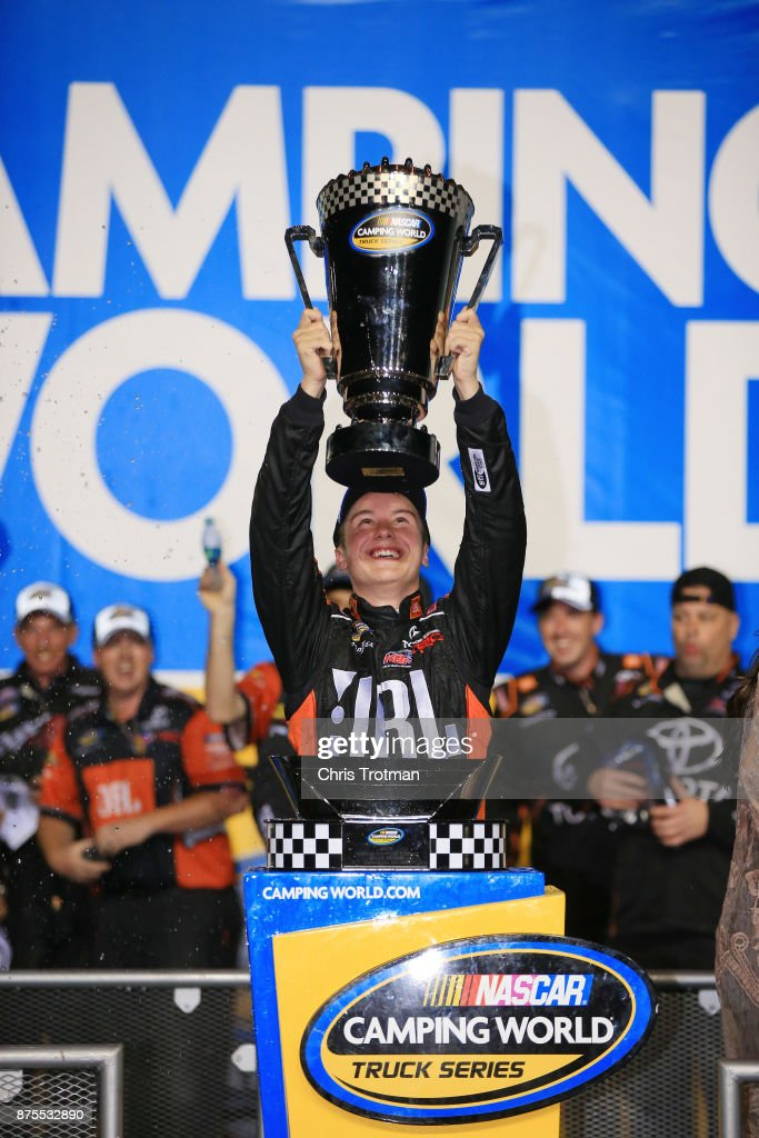 Christopher Bell, driver of the #4 JBL Toyota, celebrates with the trophy in Victory Lane after placing second and winning the Camping World Truck Series Championship during the NASCAR Camping World Truck Series Championship Ford EcoBoost 200 at Homestead-Miami Speedway on November 17, 2017 in Homestead, Florida.