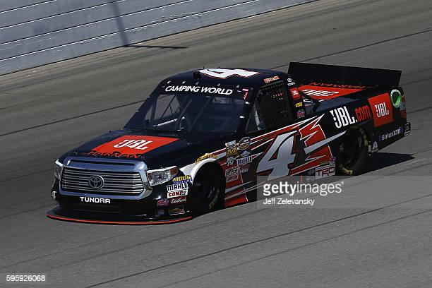 Christopher Bell driver of the JBL Toyota during practice for the NASCAR Camping World Truck Series Careers for Veterans 200 at Michigan...