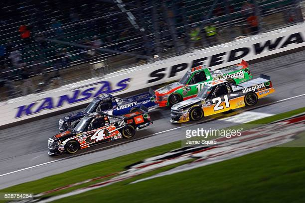 Christopher Bell driver of the JBL Toyota leads a pack of trucks during the NASCAR Camping World Truck Series Toyota Tundra 250 at Kansas Speedway on...