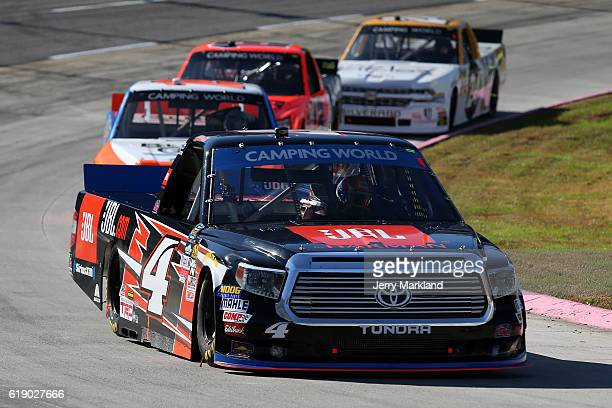 Christopher Bell driver of the JBL Toyota leads a pack of trucks during the NASCAR Camping World Truck Series Texas Roadhouse 200 presented by Alpha...