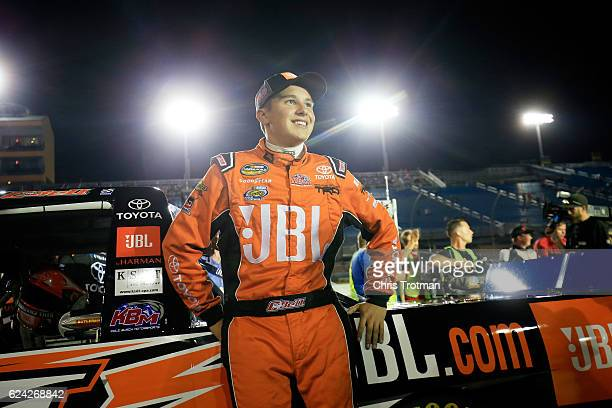 Christopher Bell driver of the JBL Toyota stands on the grid prior to the NASCAR Camping World Truck Series Ford EcoBoost 200 at HomesteadMiami...