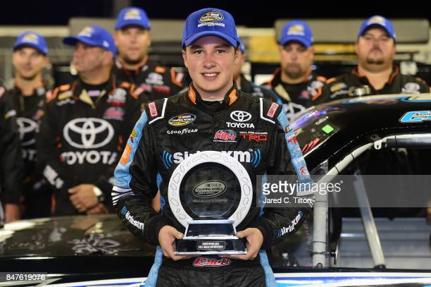 Christopher Bell driver of the SiriusXM Toyota and his team pose for a photo opportunity on pit road with the regular season champion's trophy...