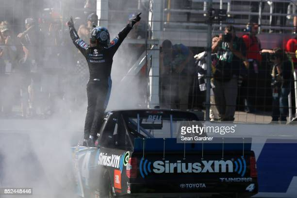 Christopher Bell driver of the SiriusXM Toyota celebrates after winning the NASCAR Camping World Truck Series UNOH 175 at New Hampshire Motor...