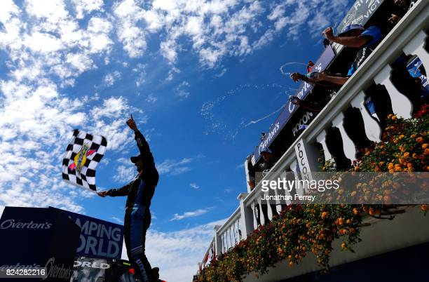 Christopher Bell driver of the SiriusXM Toyota celebrates in Victory Lane after winning the NASCAR Camping World Truck Series Overton's 150 at Pocono...