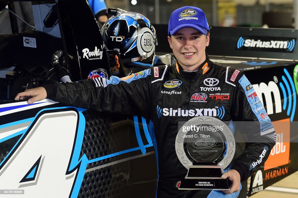 Christopher Bell, driver of the #4 SiriusXM Toyota, poses for a photo opportunity on pit road with the regular season champion's trophy following the NASCAR Camping World Truck Series TheHouse.com 225 at Chicagoland Speedway on September 15, 2017 in Joliet, Illinois.