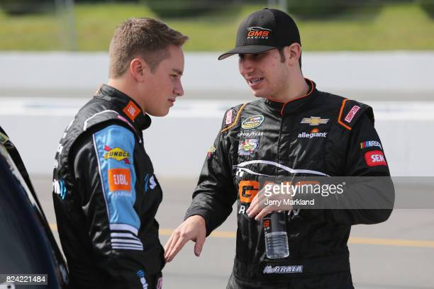 Christopher Bell driver of the SiriusXM Toyota speaks with Kaz Grala driver of the Kiklos Greek Extra Virgin Olive Oil Chevrolet on the grid during...