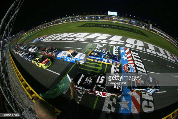 Christopher Bell driver of the SiriusXM Toyota takes the green flag to start the Camping World Truck Series North Carolina Education Lottery 200 at...