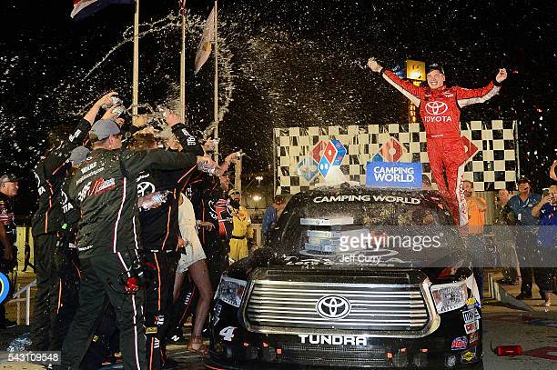 Christopher Bell driver of the Toyota Toyota celebrates with his team in victory lane after winning the NASCAR Camping World Truck Series Drivin' for...