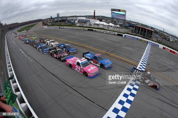Christopher Bell driver of the Toyota Toyota leads the field to the green flag to start the NASCAR Camping World Truck Series Fred's 250 at Talladega...