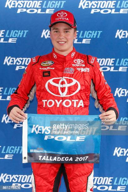 Christopher Bell driver of the Toyota Toyota poses with the Keystone Light Pole Award after qualifying in the pole position for the NASCAR Camping...