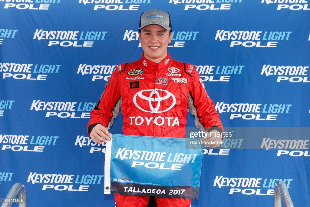 Christopher Bell, driver of the #4 Toyota Toyota, poses with the Keystone Light Pole Award after qualifying in the pole position for the NASCAR Camping World Truck Series Fred's 250 at Talladega Superspeedway on October 14, 2017 in Talladega, Alabama.