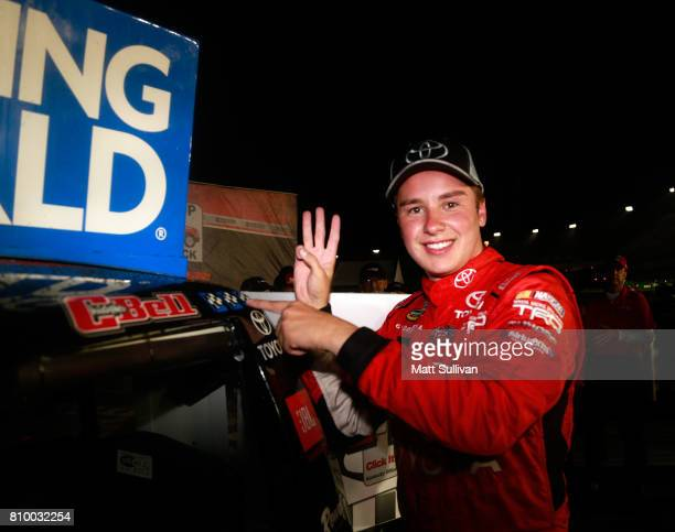 Christopher Bell driver of the Toyota Toyota poses with the winners sticker after winning the NASCAR Camping World Truck Series Buckle Up In Your...