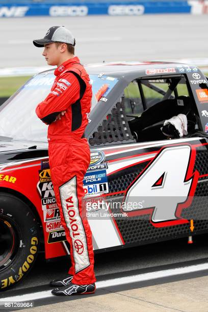 Christopher Bell driver of the Toyota Toyota stands on the grid during qualifying for the NASCAR Camping World Truck Series Fred's 250 at Talladega...