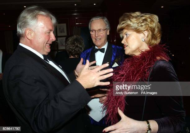 Christopher Biggins talks to Nicholas Parsons and his wife during the Variety Club 51st Annual Dinner Ball at the Grovesnor House Hotel central London