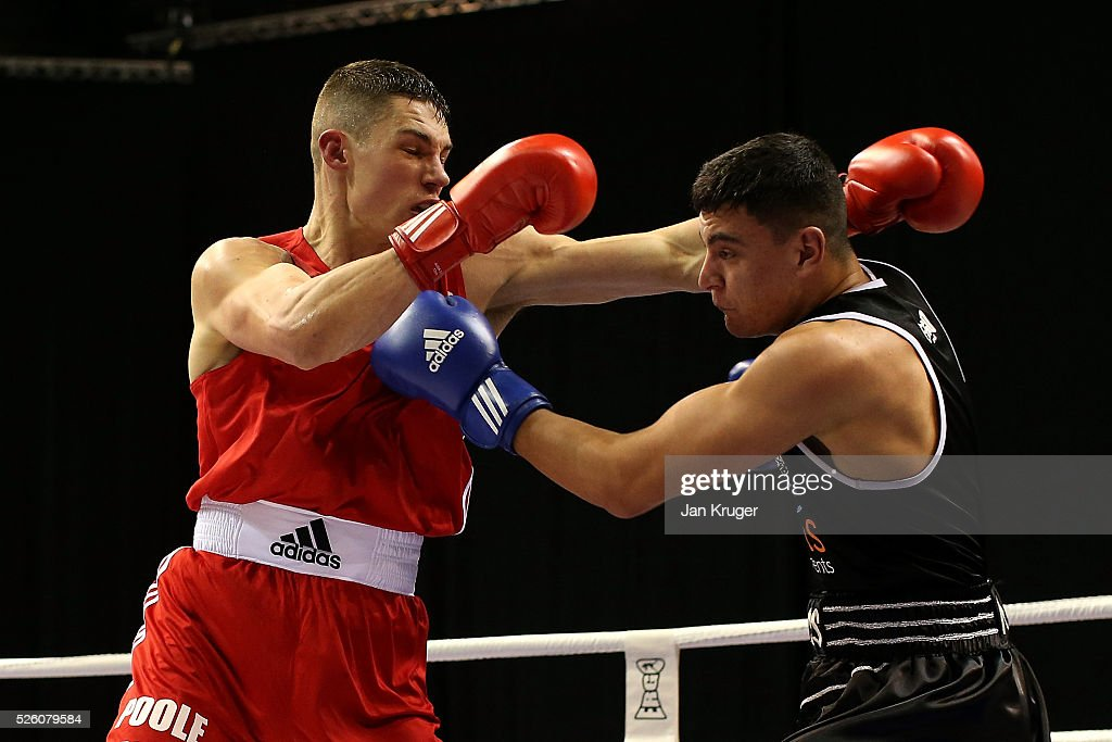 Christopher Billam-Smith (red) in action against Nathan Quarless in their 91kg quarter final fight during day one of the Boxing Elite National Championships at Echo Arena on April 29, 2016 in Liverpool, England.