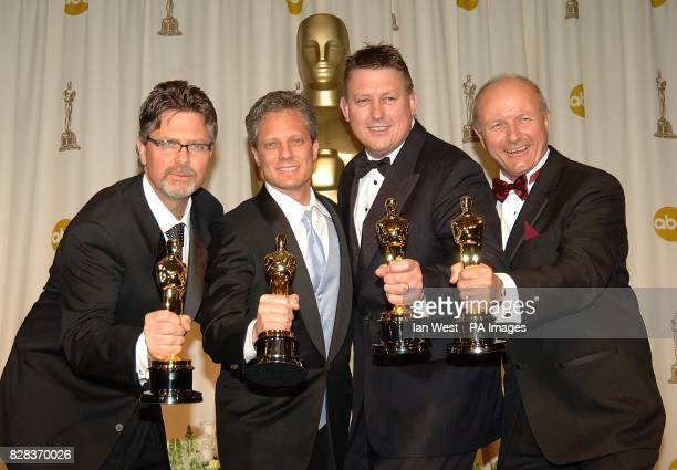 Christopher Boyes Michael Semanick Michael Hedges and Hammond Peek with their awards for Best Sound Mixing for King Kong