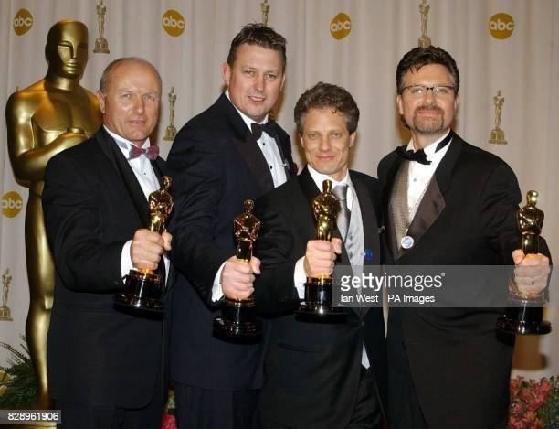 Christopher Boyes Michael Semanick Michael Hedges and Hammond Peek with their Oscars for Sound Mixing for Lord of the Rings The Return of the King at...