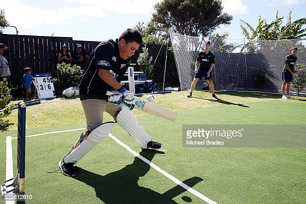Christopher BrabantHenry aged 14 bats after he and his sister Regan aged 7 from Mangere returned home to find the ultimate family cricket set up and...