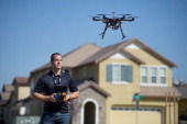 Christopher Brown coowner of Next New Homes Group uses his multirotor helicopter drone to take aerial video of a home in Sacramento Calif on February...