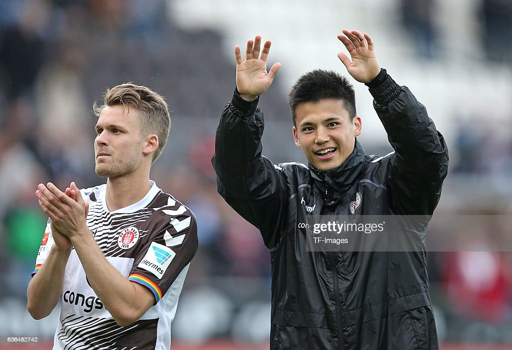 Christopher Buchtmann of FC St. Pauli , Ryo Miyaichi of FC St. Pauli celebrates the win after the Second Bundesliga match between FC St. Pauli and 1. FC Kaiserslautern at Millerntor-Stadion on May 15, 2016 in Hamburg, Germany.