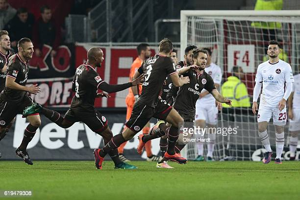 Christopher Buchtmann of Pauli celebrates after scoring their first goal during the Second Bundesliga match between FC St Pauli and 1 FC Nuernberg at...