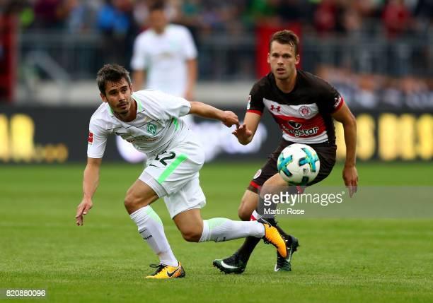 Christopher Buchtmann of St Pauli and Fin Bartels Bremen battle for the ball during the preseason friendly match between FC St Pauli and Werder...